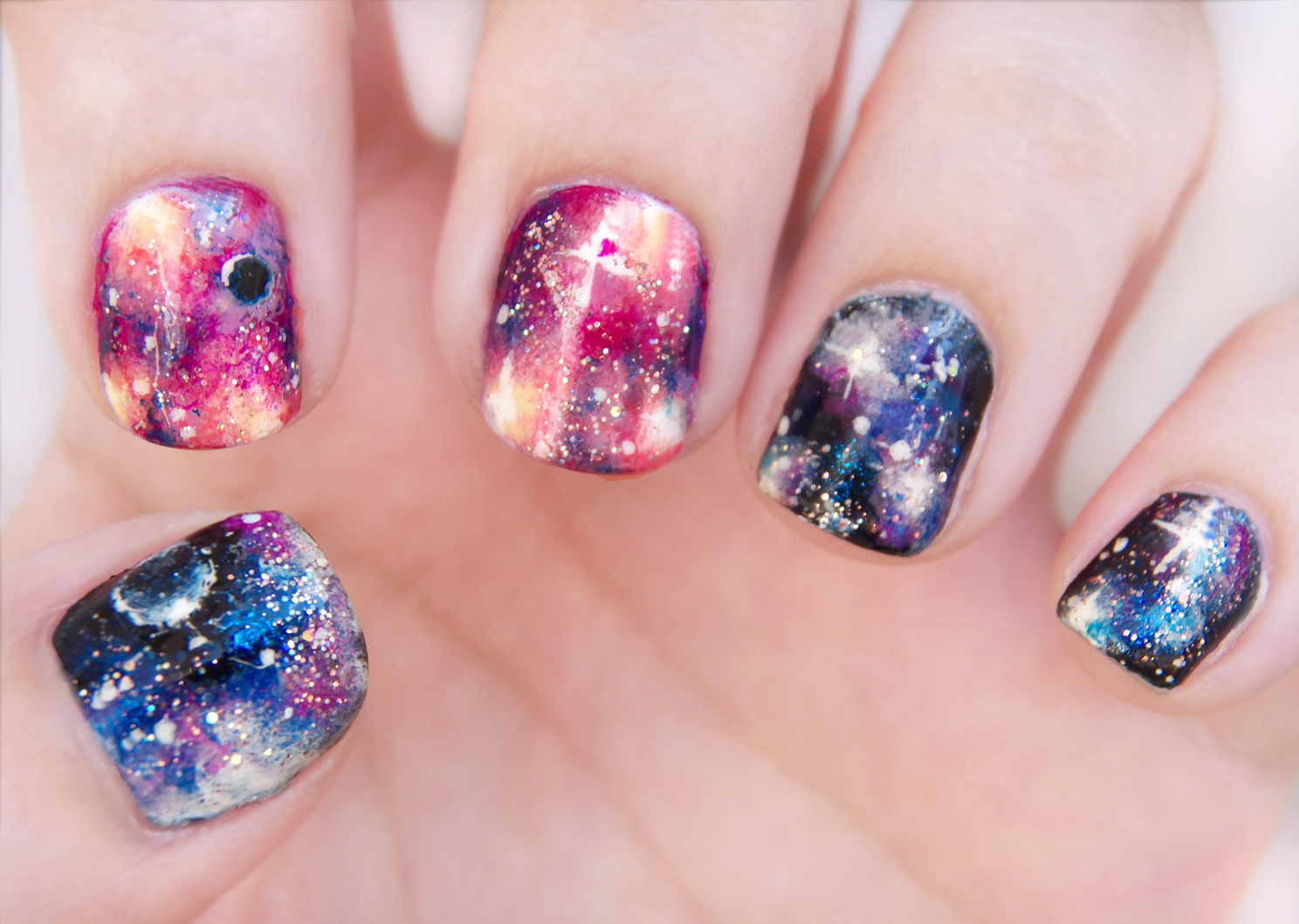 Sophisticated Galaxy Art for Lustrous Nails