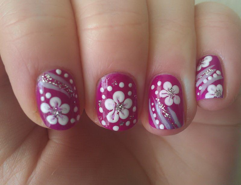 White Flower on Pink Nail